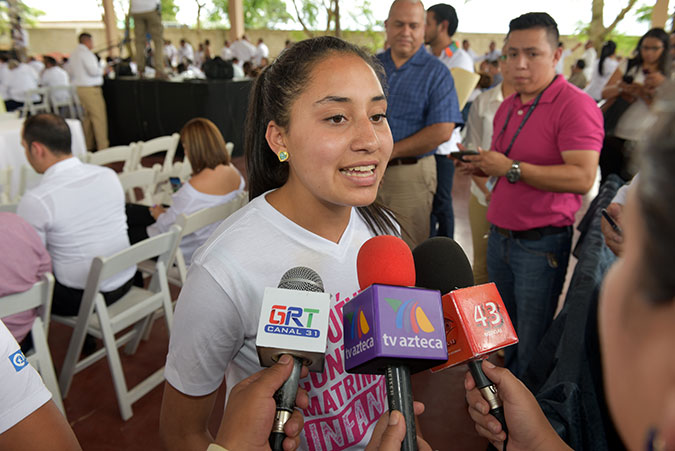 A youth advocate is interviewed in Honduras