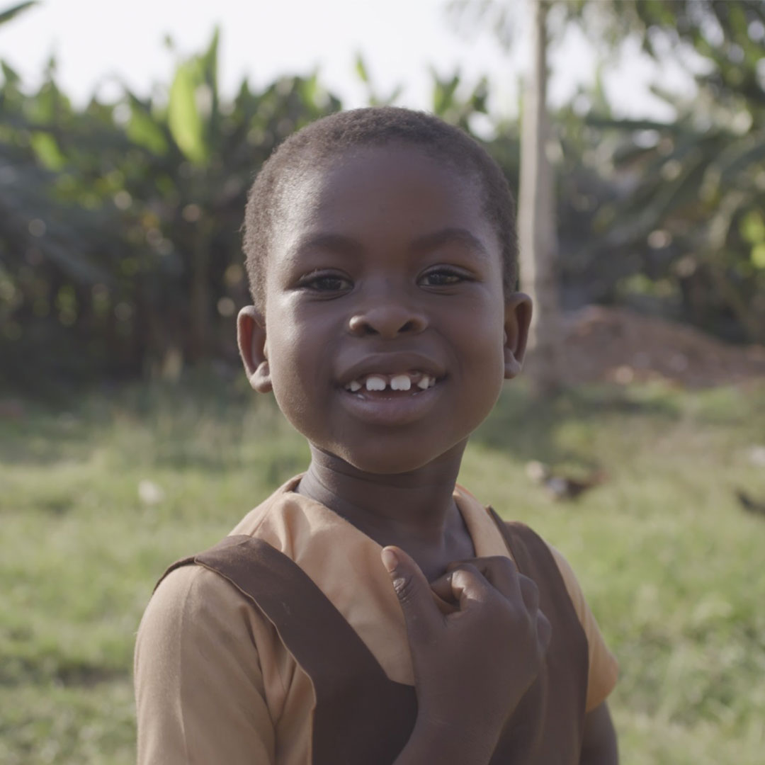 Sponsored child in Ghana smiles into the camera