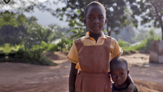 Sponsored children in Ghana with their arms around each other, showing us sponsorship through their eyes