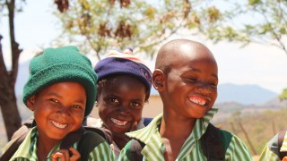 children-smiling-on-the-way-to-school