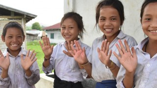 Children learn handwashing skills in Laos