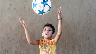 A boy playing football in Brazil
