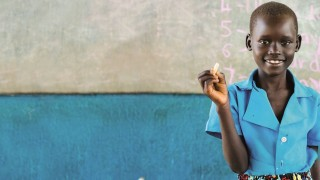 A girl at school in Uganda
