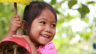 A girl plays at an Early Childhood Care and Development centre in Cambodia