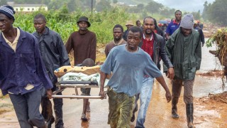 A rescued man carried on a stretcher after the cyclone in Zimbabwe