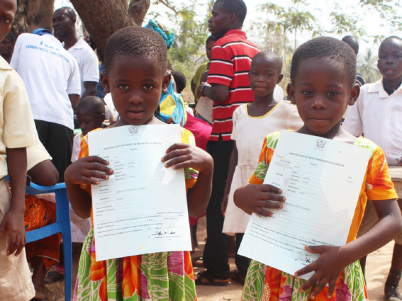 Mary and Martha stand proudly with their birth certificates