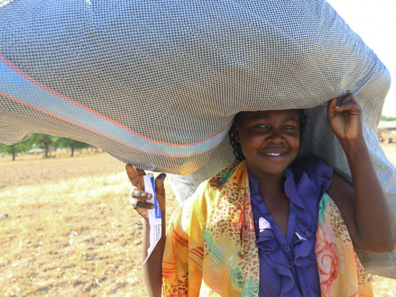 A Nigerian woman recieves aid from Plan International UK