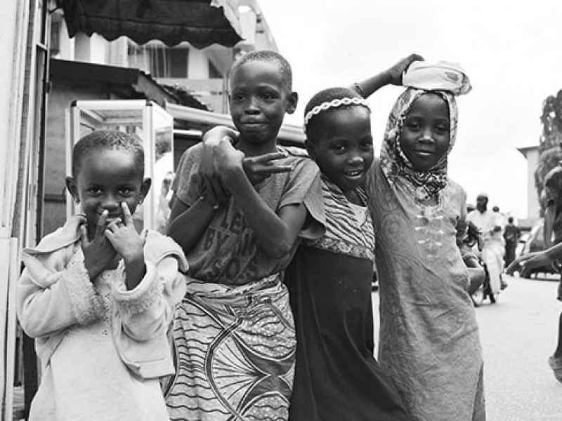 Ghana-Group of (unknown) young children passing in Nima