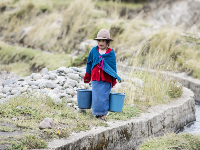 Jenny on her way home after collecting water in the Andes