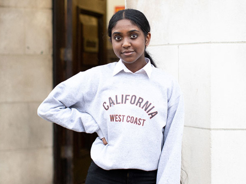 Photo of a girl in a grey jumper