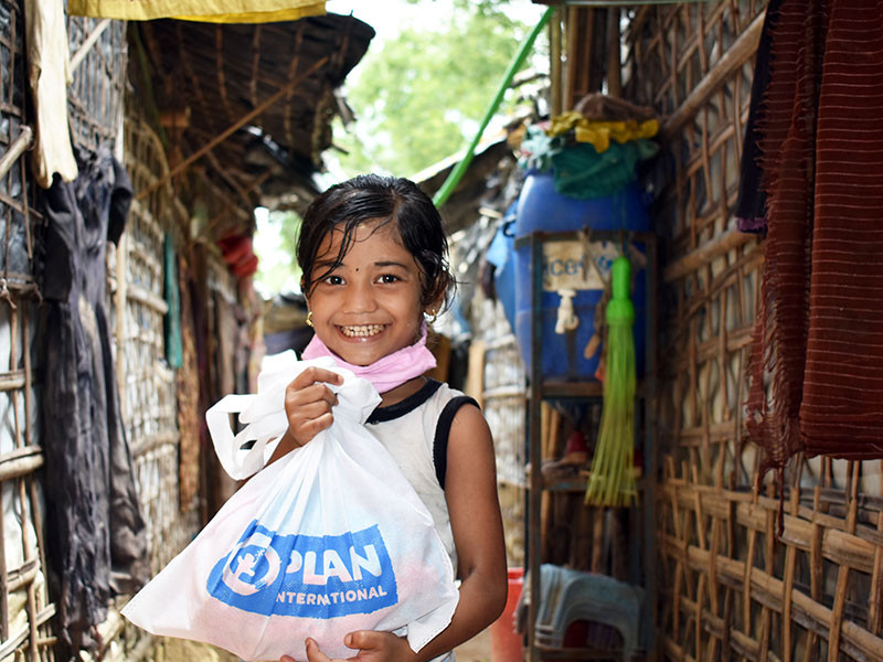 Photo of a girl holding a hygiene kit