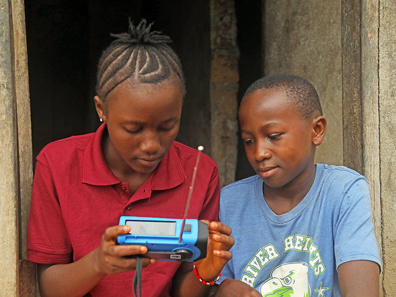 Photo of two children with a radio