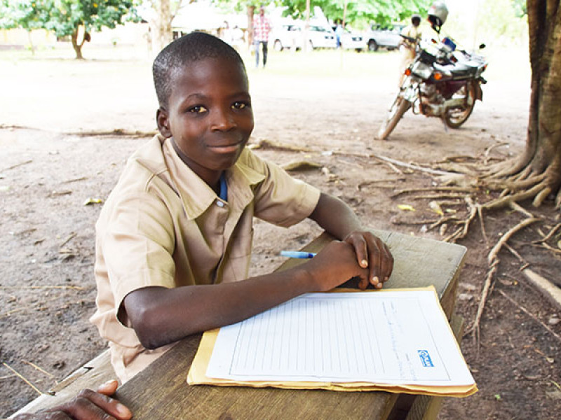 Photo of a boy writing a letter