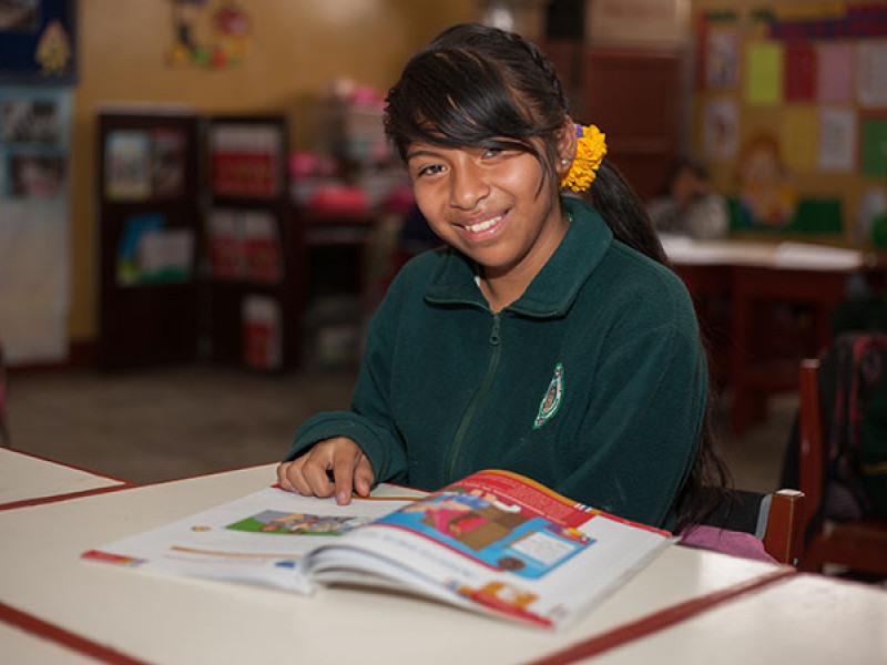 A girl studies in a classroom in Peru