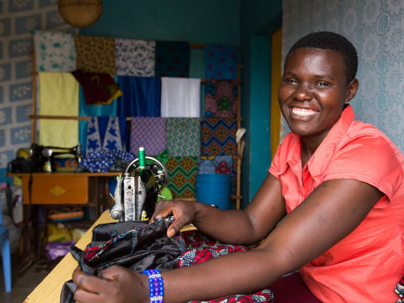 Nyamburi with a sewing machine in Tanzania