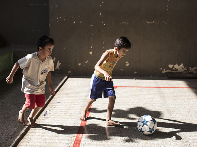 Fernando and a friend play football in Brazil