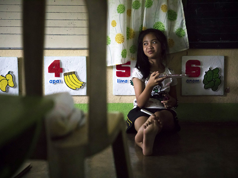 A girl at a school which has been turned into an evacuation centre in the Philippines