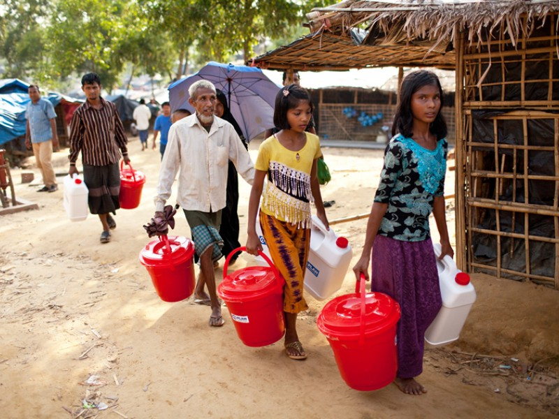 A family collect hygiene kits together in Cox's Bazar, Bangladesh