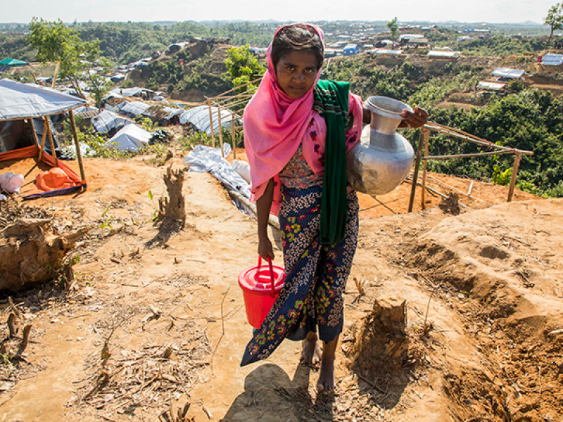 Photo of a girl carrying water