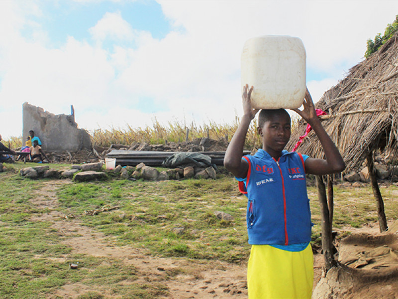 Munashe, 14, on her way to collect water for her family
