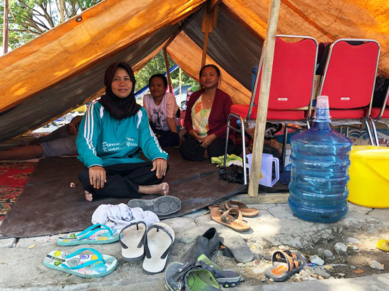 Mrs Hartini in the tent she and her family are sharing with two other families in Palu.