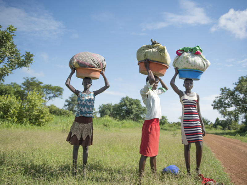Girls carry washing to the river in South Sudan