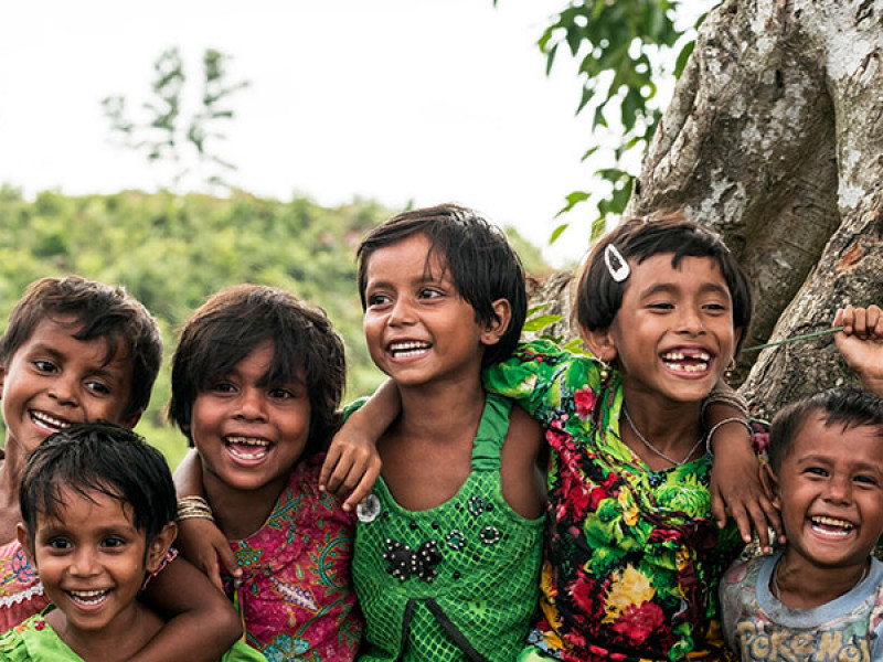 A group of children smiling