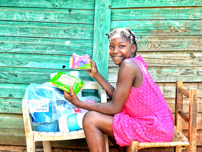 Photo of a girl holding sanitary products
