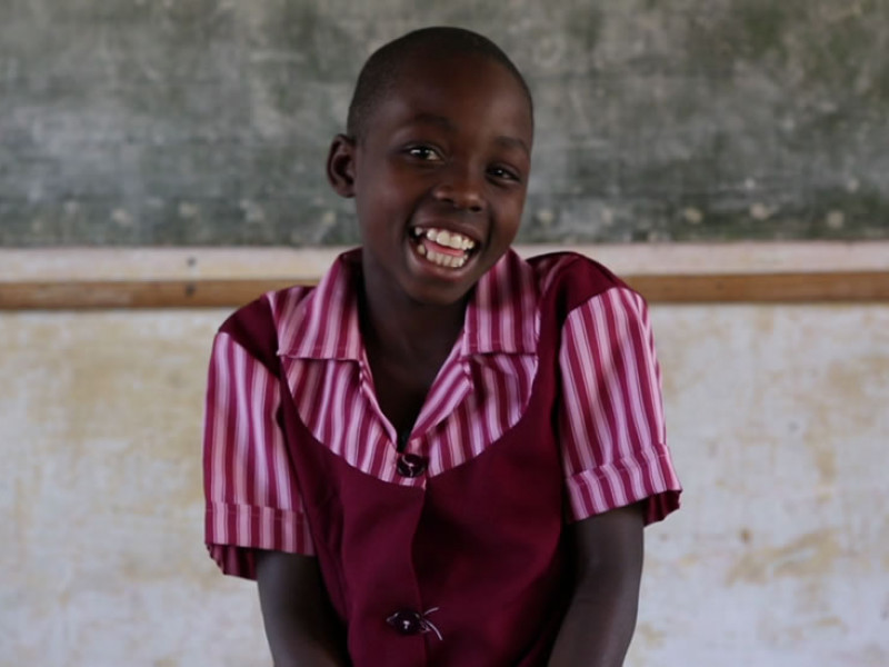 Eudel, 8, is sponsored through Plan International. She loves going to school in Zimbabwe.