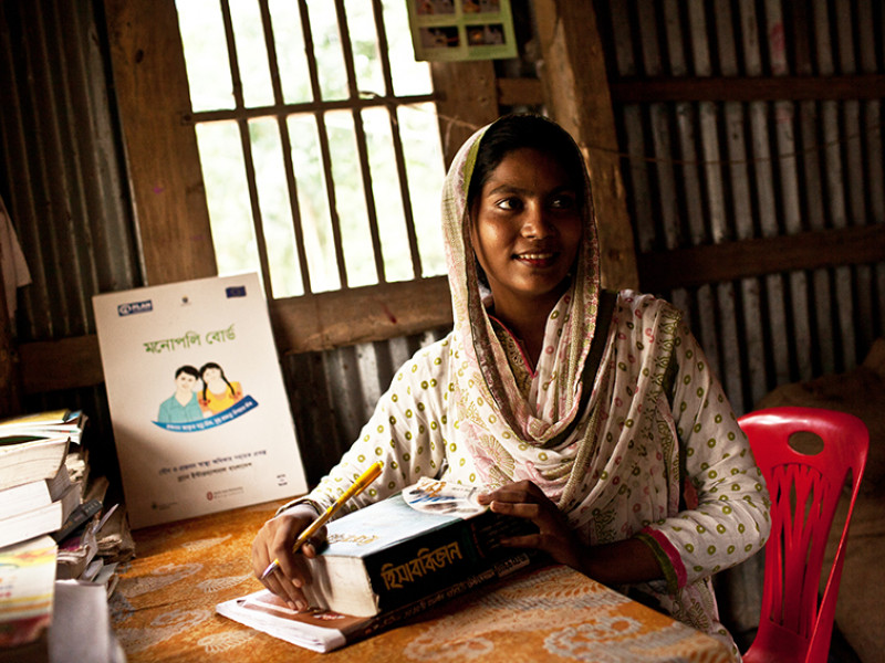Sazeda studies at home in Bangladesh