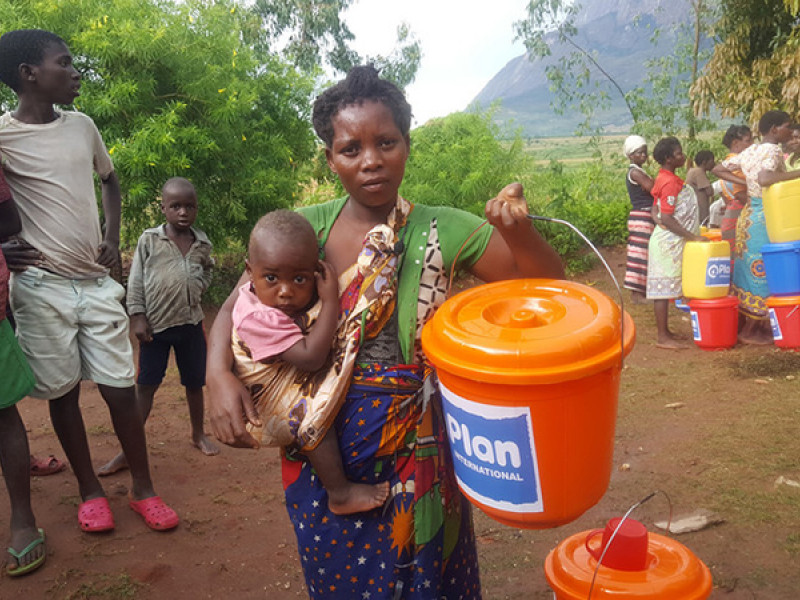 Women receive Plan International WASH kits in Malawi