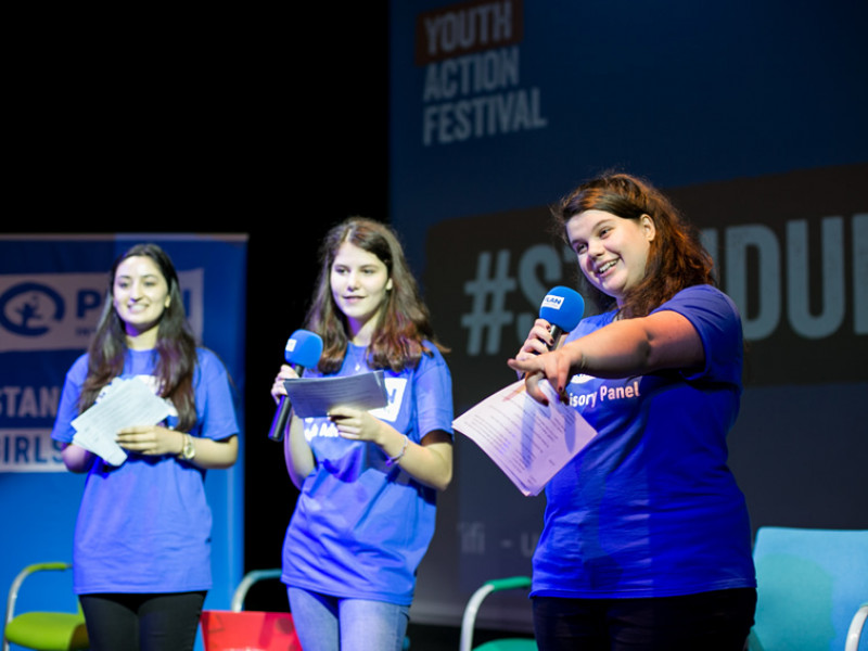 Three members of the Youth Advisory Panel speak at the Youth Action Festival