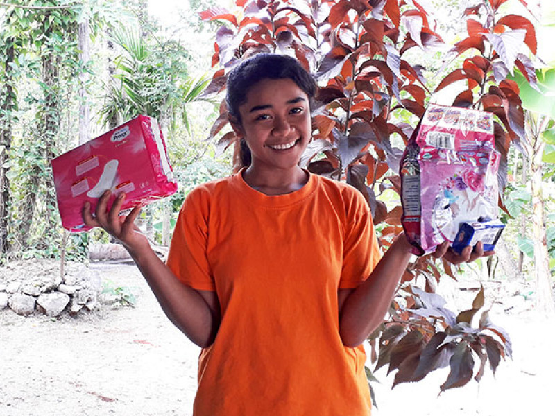 Photo of a girl holding period products