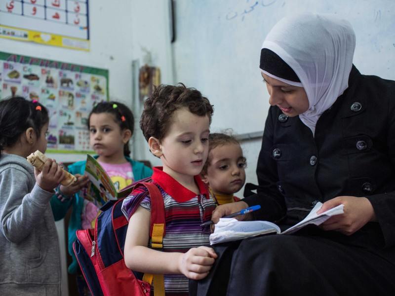 Syrian mum reads to her child