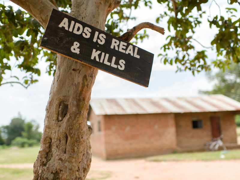 Sign outside a Plan participation centre reads Aids is real