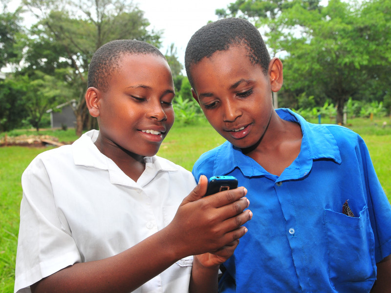 Children in Uganda are taught to use mobiles to report when teachers are absent from school