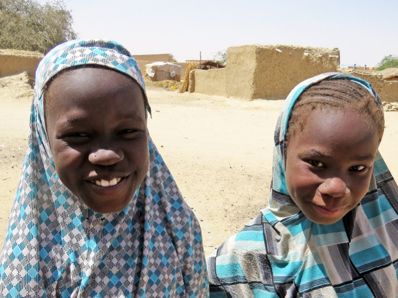 Faltima and her friend enjoy going to a Plan International child-friendly space
