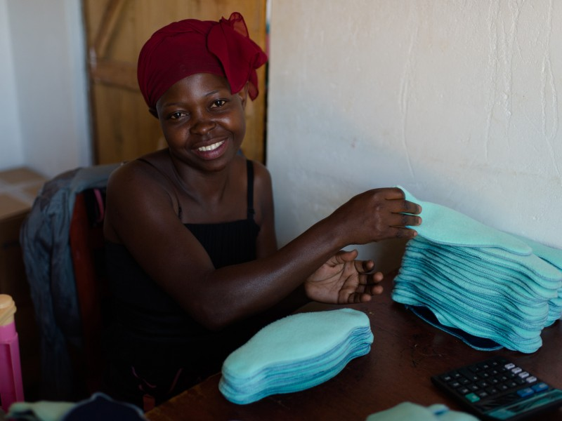 A girl in Uganda is able to make and sell afripads to other young women in her community