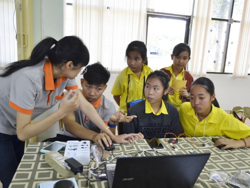 Girls take part in a microbit workshop at school in Thailand
