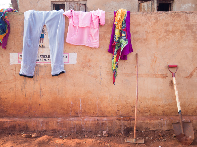 Clothes drying on the wall of the wash block in Nyarugusu camp