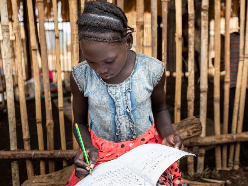 Nya Bahn does her homework, Ethiopia, 2020