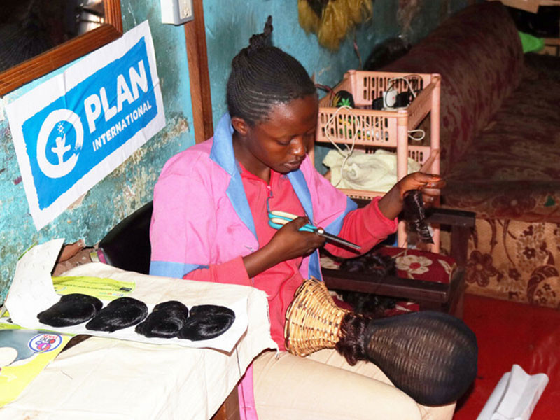 Plan International UK. Girl learns hairdressing skills at training centre in Cameroon