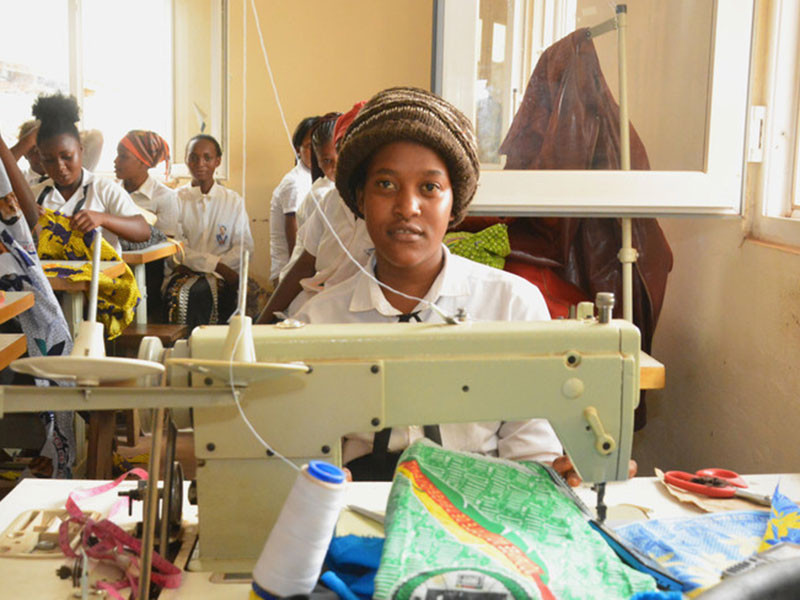 Girls learning tailoring skills at youth livelihood project in Cameroon