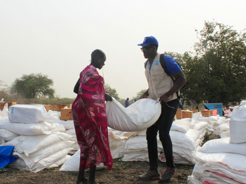 A woman collects food aid during distribution in Pibor county, South Sudan