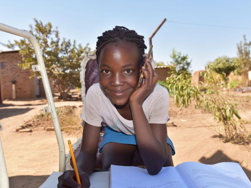 Yolanda speaks with a community educator, Zimbabwe, 2020.