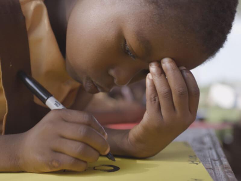 Child writing, Ghana