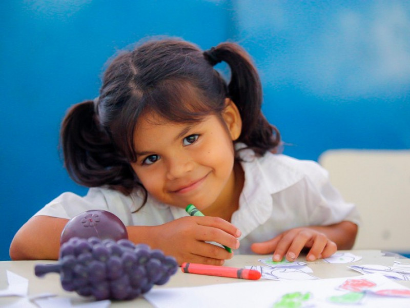 Girl writing sponsored child
