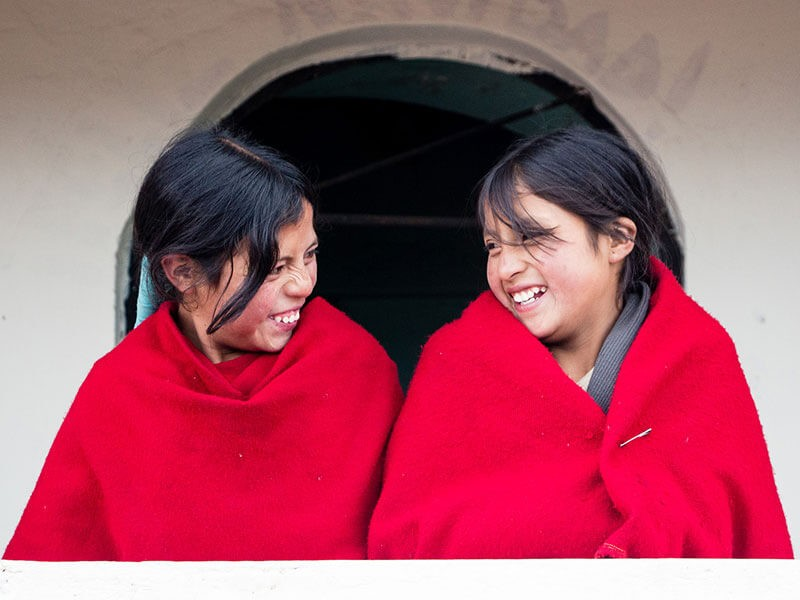 Girls sharing a joke in Ecuador