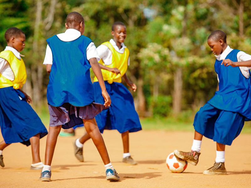 A group of young people playing football