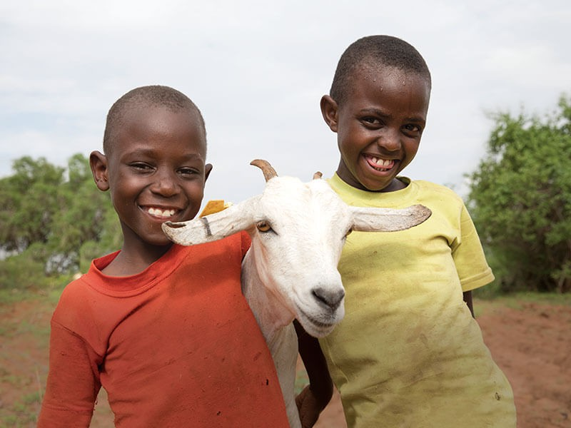 6 year-old Nzioki and 8 year-old Lucia with Munai, their goat